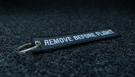 Black Embroidered Remove Before Flight Keychain 5.5x1.8